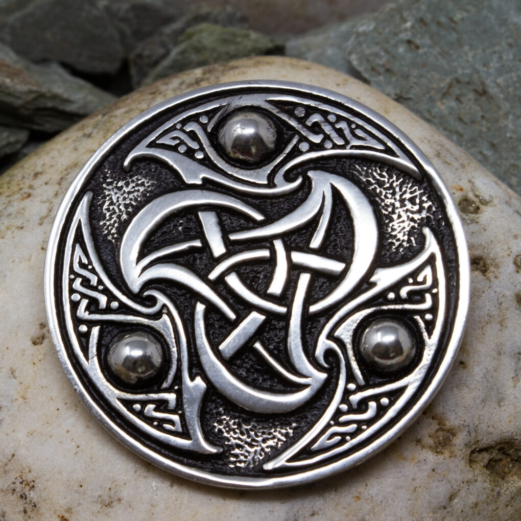 a celtic triscele brooch in pewter