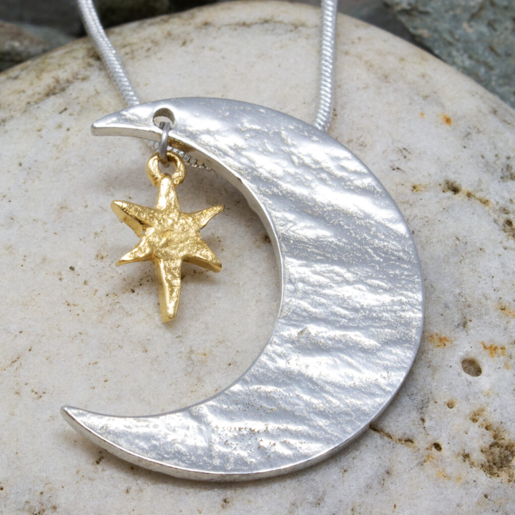 this is a two tone pewter moon and stars pendant from Eyres Jewellery