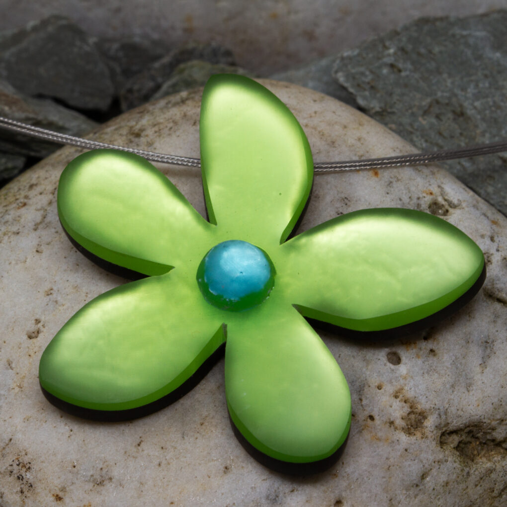 a hand crafted flower pendant