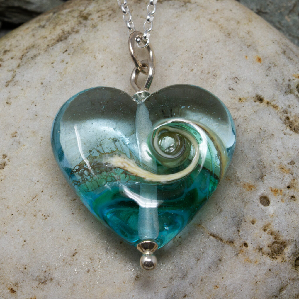 Heart and glass pendant part of the Turning Tides Charity Collection