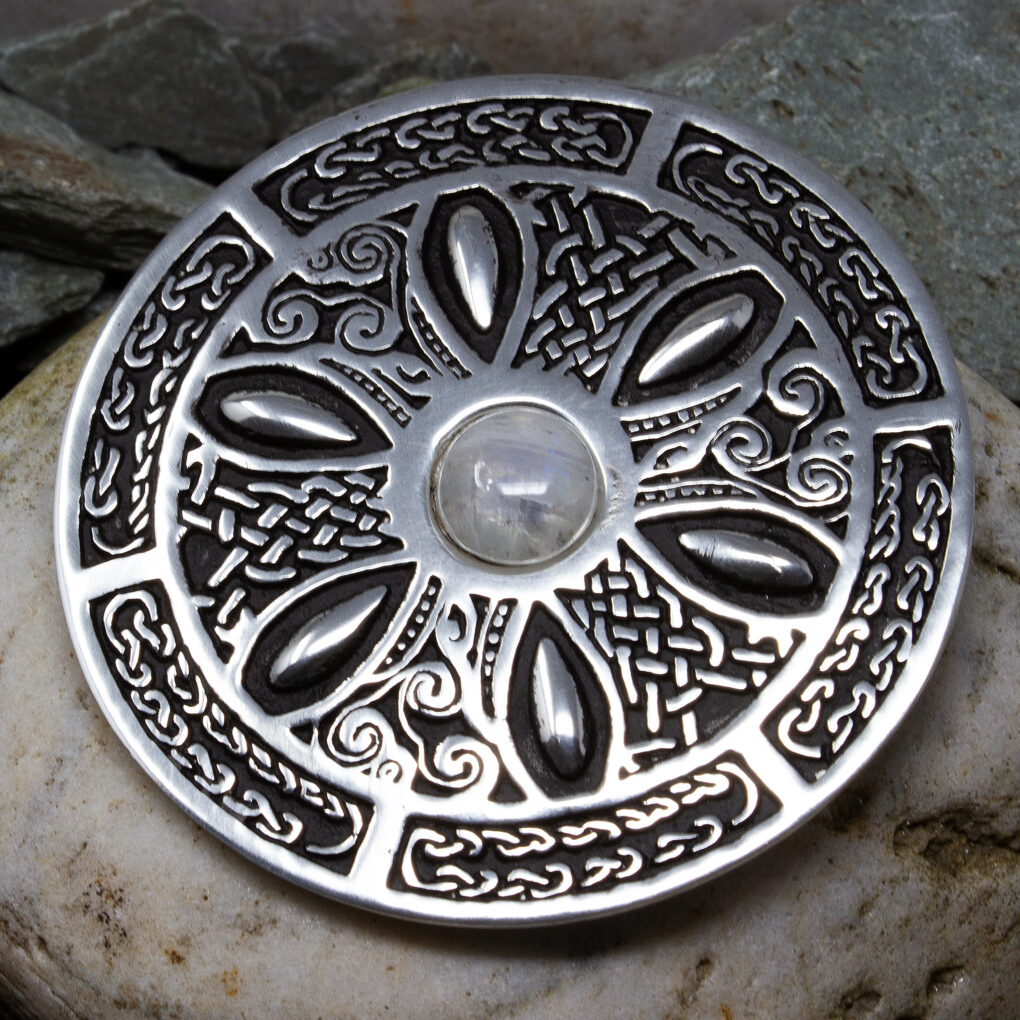 a celtic Wheel Gemstone Brooch