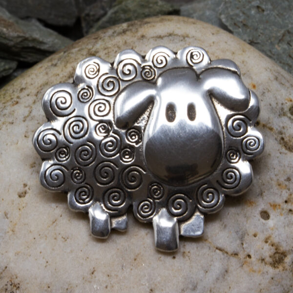 a sheep brooch made from pewter