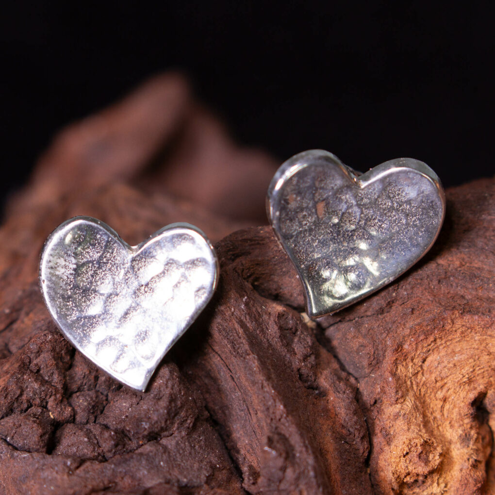 a pair of heart stud earrings