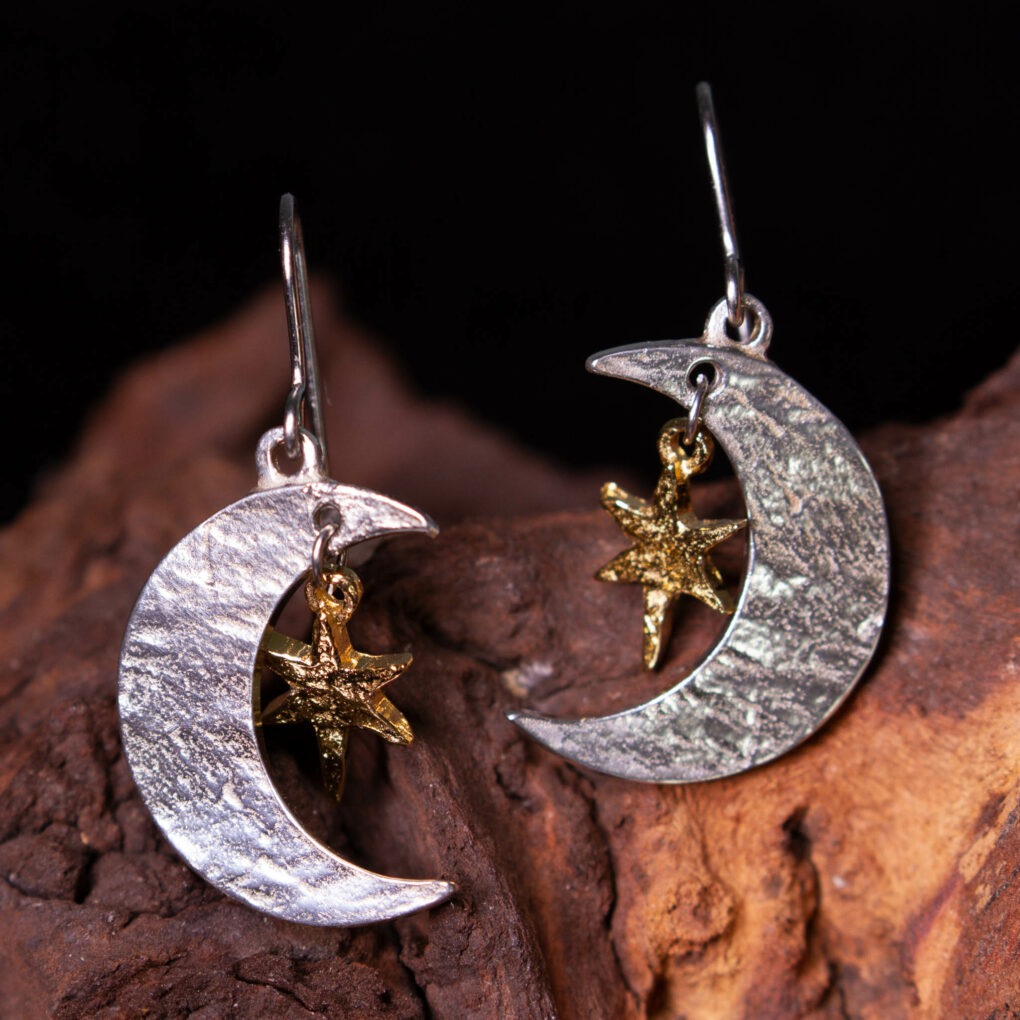 a pair of moon and stars earrings