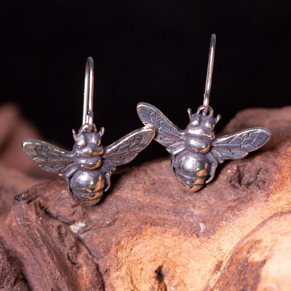a pair of pewter bee earrings