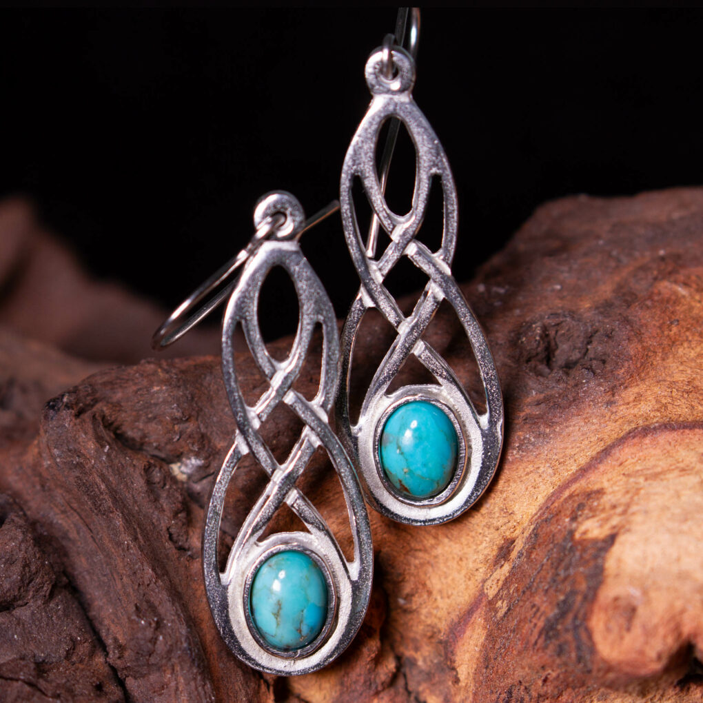 a pair of turquoise celtic earrings