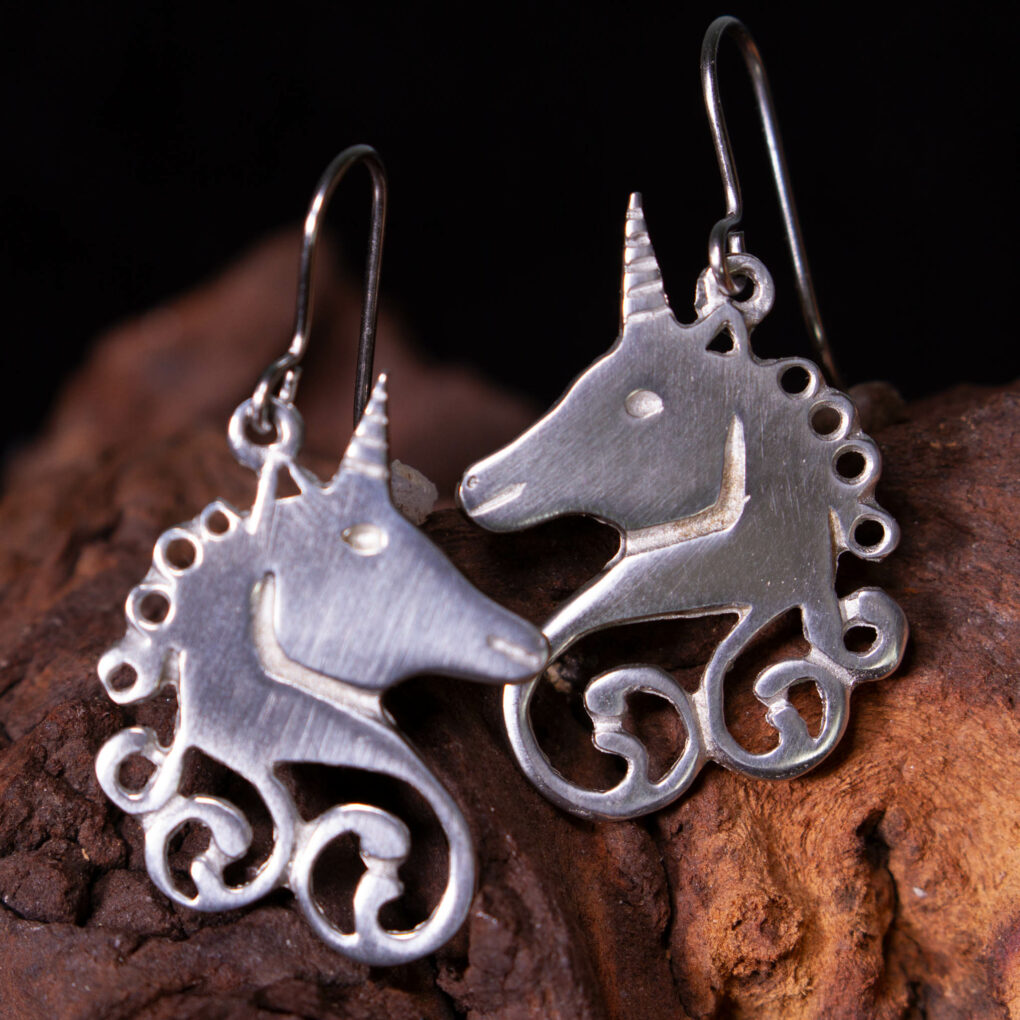 a pair of unicorn earrings