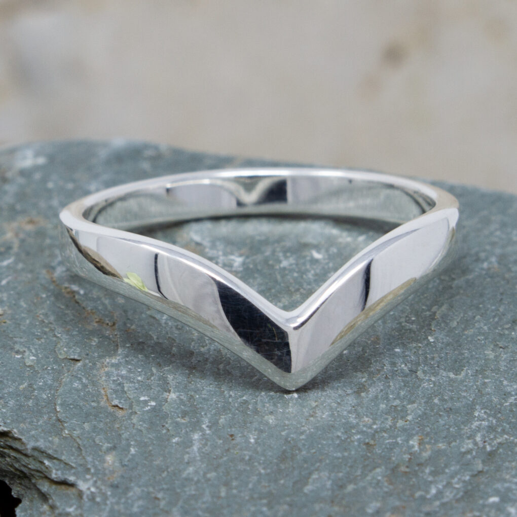 A lovely simple ring fashioned into the shape of a wishbone.