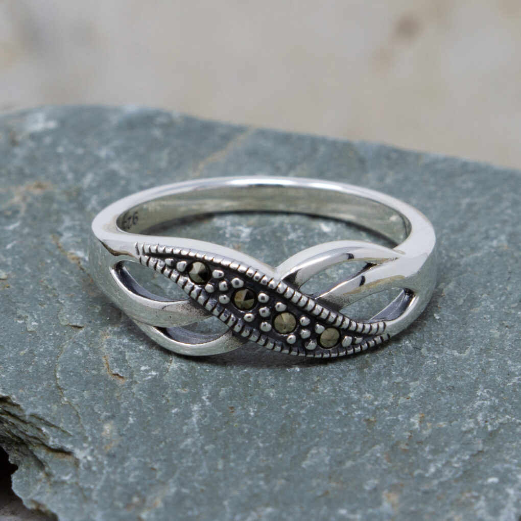 Silver ring with marcasite twist detail