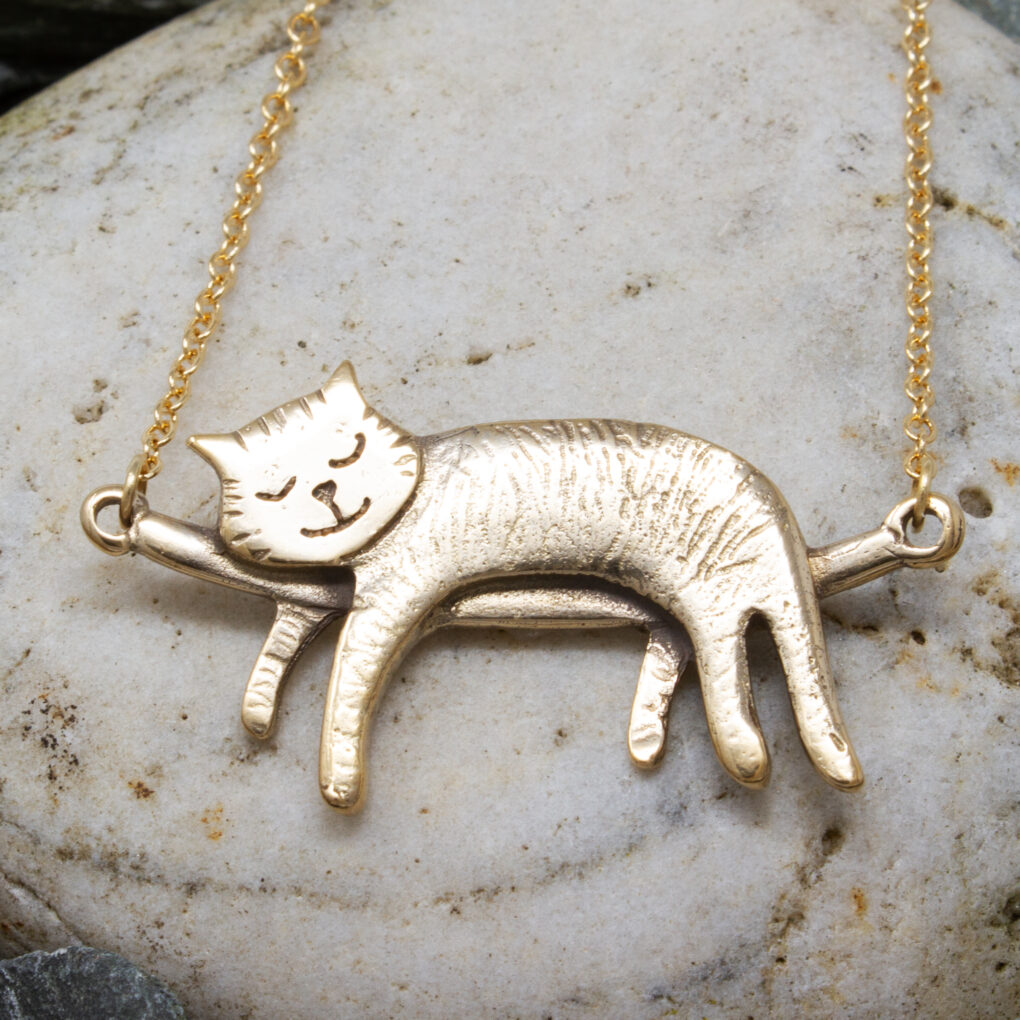 bronze sleeping cat necklace