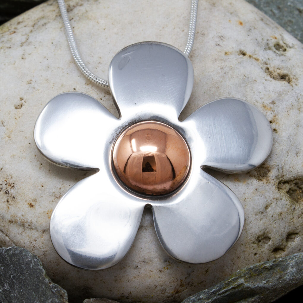 copper centre flower pendant