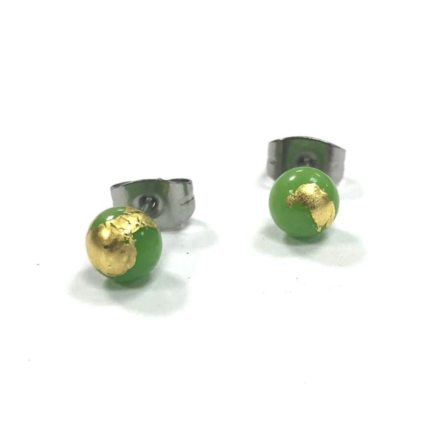 A lovely little pair of handmade glass stud earrings in apple green with flecks of 24 carat gold leaf.